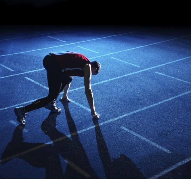 Athlete starting on running track